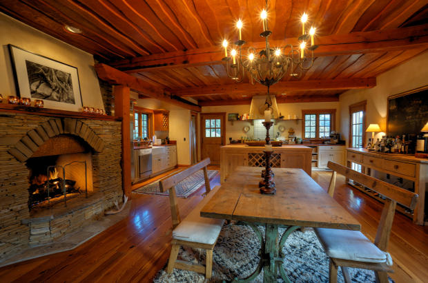 Dining room fireplace wood floor Cascabel Ranch Colorado