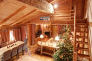Open plan dining living room wood stairs Le Clarmont Penthouse Verbier