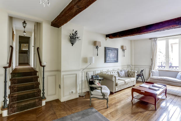 Living room wood floors beams stairs Rue de Turenne Paris