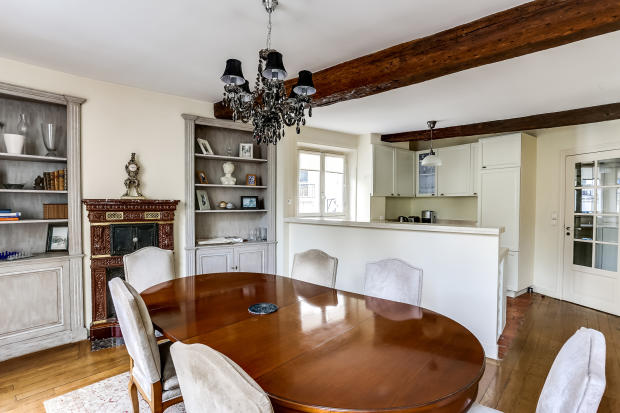 Dining room wood floors beams fireplace Rue de Turenne Paris