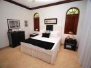 Bedroom marble floor shutters Monkey Business Barbados