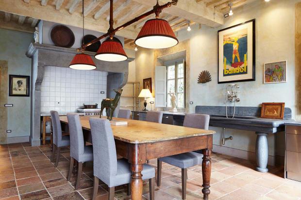 Kitchen dining room tiled floor Villa La Quercia Lucca Tuscany