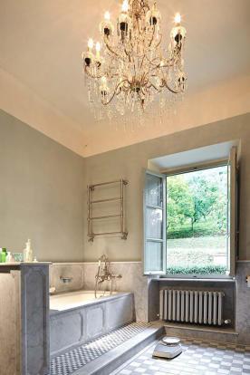Bathroom bath tub tiled floor chandelier Villa La Quercia Lucca Tuscany