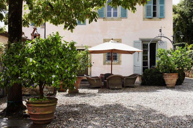 Dining area outdoor courtyard Villa La Quercia Lucca Tuscany