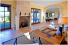 Living room french doors tiled floor fireplace Finca Son Romani Mallorca