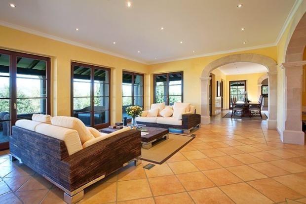 Living room french doors tiled floor fireplace Finca Son Romani Mallorca
