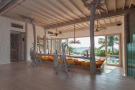 Living room wood floor sliding doors ocean sea view Villa Sunrise at Soneva Fushi Maldives