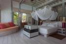 Bedroom master ensuite wood floor Villa Sunrise at Soneva Fushi Maldives