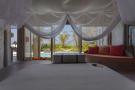 Bedroom master view sliding french doors Villa Sunrise at Soneva Fushi Maldives