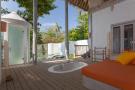 Covered terrace bath tub wood floor shower Villa Sunrise at Soneva Fushi Maldives