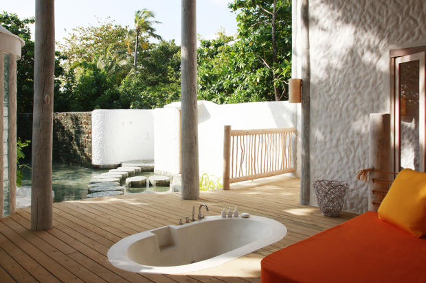 Covered terrace bath tub wood floor Villa Sunrise at Soneva Fushi Maldives
