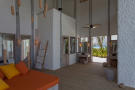 Bedroom ensuite wood floor Villa Sunrise at Soneva Fushi Maldives