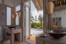 Bathroom twin sink french doors wood Villa Sunrise at Soneva Fushi Maldives