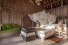 Bedroom master wood floor full height ceiling Villa Sunrise at Soneva Fushi Maldives