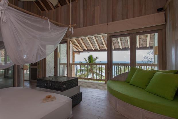 Bedroom master wood floor ocean sea view Villa Sunrise at Soneva Fushi Maldives