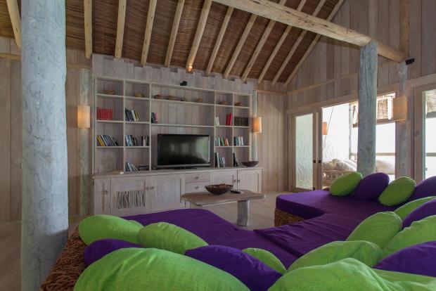 Living room wood column Villa Sunrise at Soneva Fushi Maldives