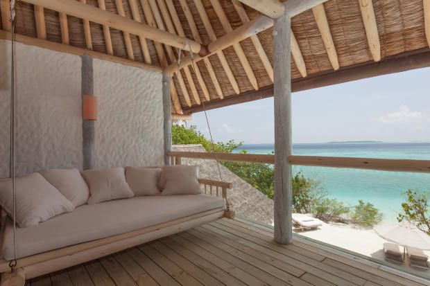 Covered terrace hanging chair wood ocean sea view Villa Sunrise at Soneva Fushi Maldives