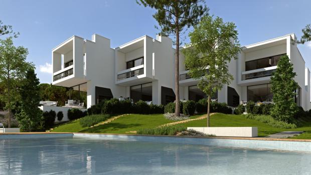 Rear facade view garden swimming pool La Balca Town Houses PGA Catalunya Girona