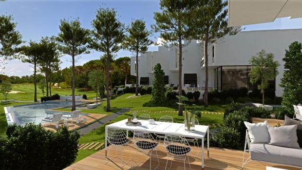 Swimming pool outdoor dining area terrace view La Balca Town Houses PGA Catalunya Girona