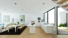 Living room dining kitchen open plan fireplace breakfast bar La Balca Town Houses PGA Catalunya Girona