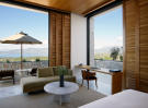 Living room sliding doors terrace Amanzoe Peloponnese
