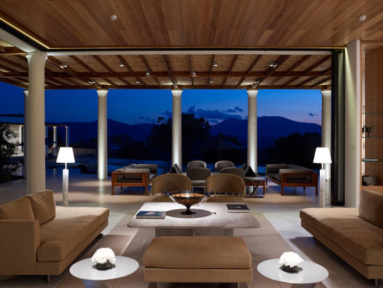 Living room open plan sliding doors Amanzoe Peloponnese