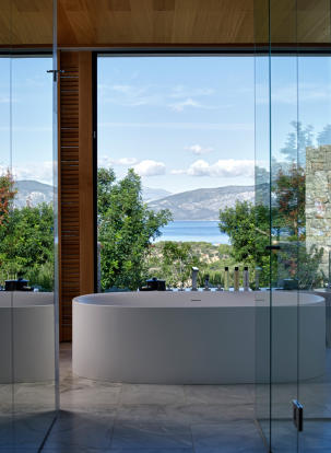 Bathroom bath tub stone ocean sea view Amanzoe Peloponnese
