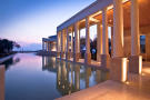 Swimming pool stone column dusk Amanzoe Peloponnese