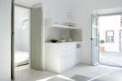 Bedroom ensuite bathroom stone floor french doors Villa Fabrica Santorini