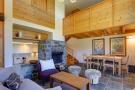 Open plan living area with mezzanine floor at Chalet Lievre in Verbier