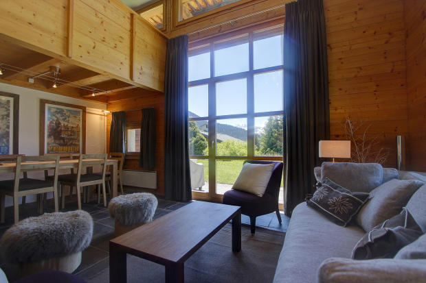 Open plan living room and dining room at Chalet Lievre in Verbier