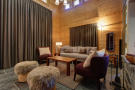 Living room with double height ceiling at Chalet Lievre in Verbier