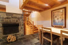 Stairwell and dining area at Chalet Lievre in Verbier