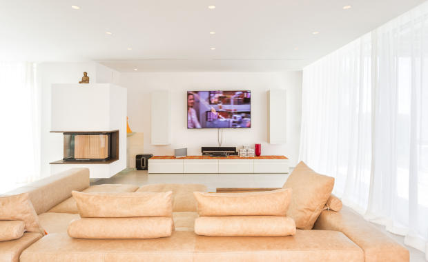 TV lounge with fireplace at Villa Roberta in Ibiza
