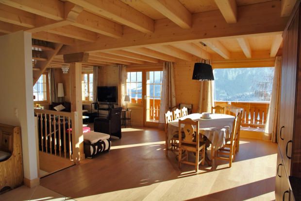 Open plan dining and living room at Chalet Alina