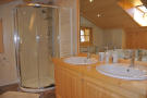 Large master bathroom with shower at Chalet Alina