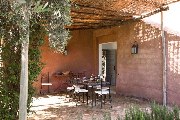 Outdoor covered patio at Villa Jardin