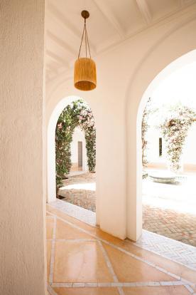 Corridor and archways onto inner courtyard at Villa Jardin