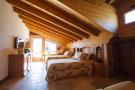 Bedroom twin guest balcony doors Chalet La Courtiliere Verbier