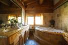 Bathroom twin sink bath tub tiled Chalet La Courtiliere Verbier