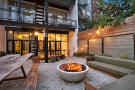 Backyard with fire pit at 550 Grand Street in Brooklyn, New York