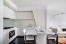 Built in kitchen and dining area at 123 Washington Street, Unit 36E