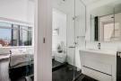 En suite bathroom looking into bedroom at 123 Washington Street, Unit 36E