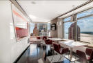Kitchen and dining with city and river views at 123 Washington Street
