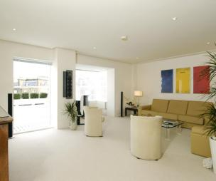 photo of contemporary open plan beige white living room