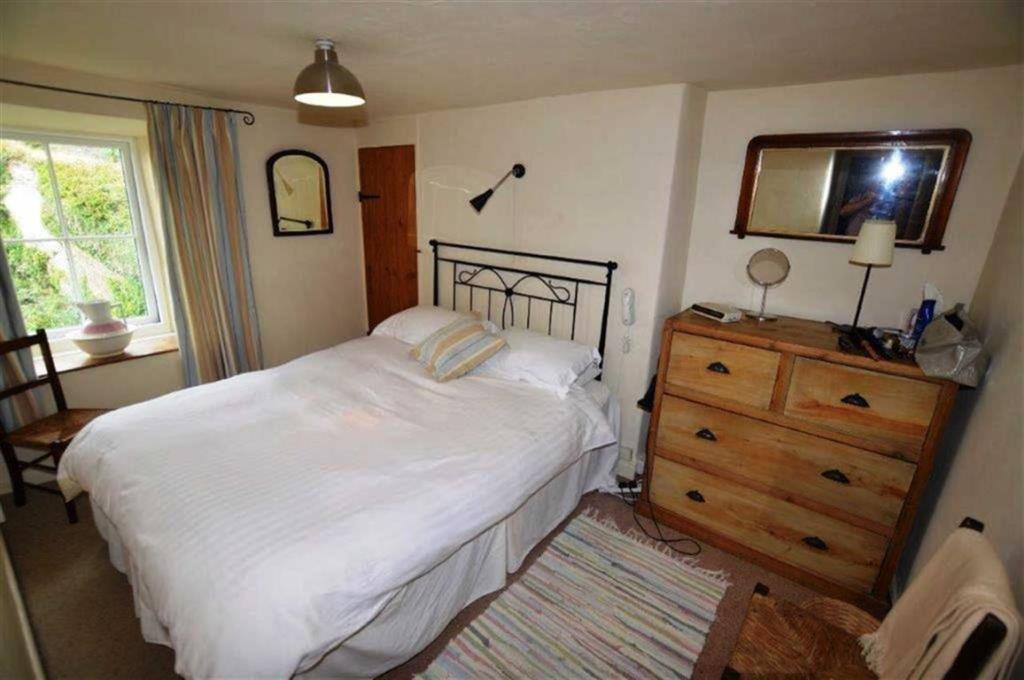 Bedroom One: (front)