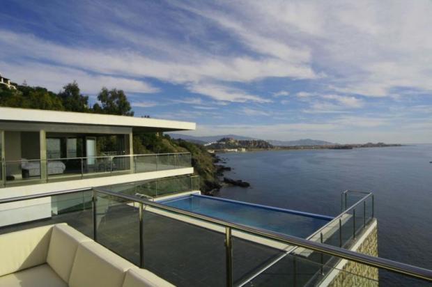 Impressive villa located directly above the sea