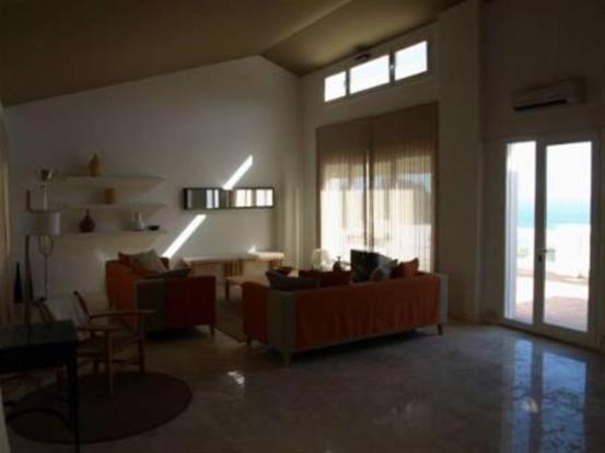 Lounge has vaulted ceilings, terrace & sea views