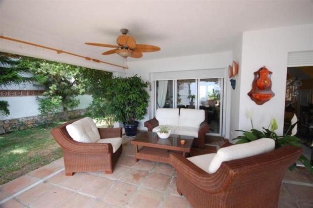 Stay cool on the covered porch near pool & garden