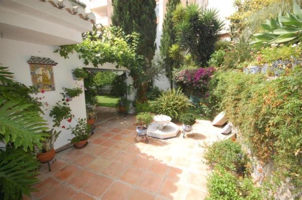 Back terrace with fountain & more garden area